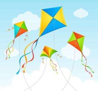 four kites flying in blue sky with clouds